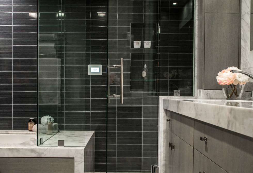 black+tile+wall+behind+tub+through+shower